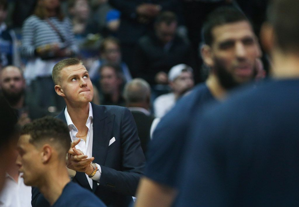 FILE - Kristaps Porzingis looks to the scoreboard before the start of a game between the Mavericks and the Charlotte Hornets on Wednesday, Feb. 6, 2019, at American Airlines Center in Dallas. (Ryan Michalesko/The Dallas Morning News)