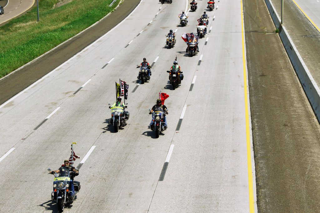 Members of the Patriot Guard Riders were part of the escort for the remains of George A. Coke Jr., an Arlington sailor killed during the attack on Pearl Harbor Friday, June 23, 2017, Photograph on are escorted down State Highway 360 in Fort Worth after leaving at DFW Airport.