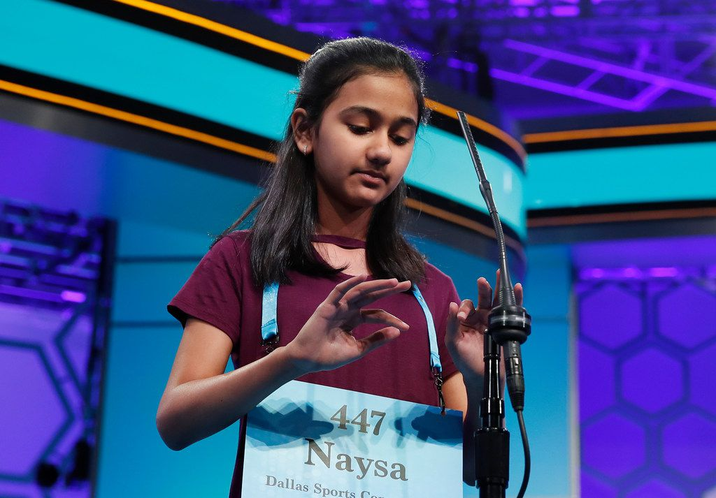 Naysa Modi, 12, from Frisco, Texas, types on an imaginary keyboard as she spells a word correctly during the final round of the Scripps National Spelling Bee in Oxon Hill, Md., Thursday, May 31, 2018.