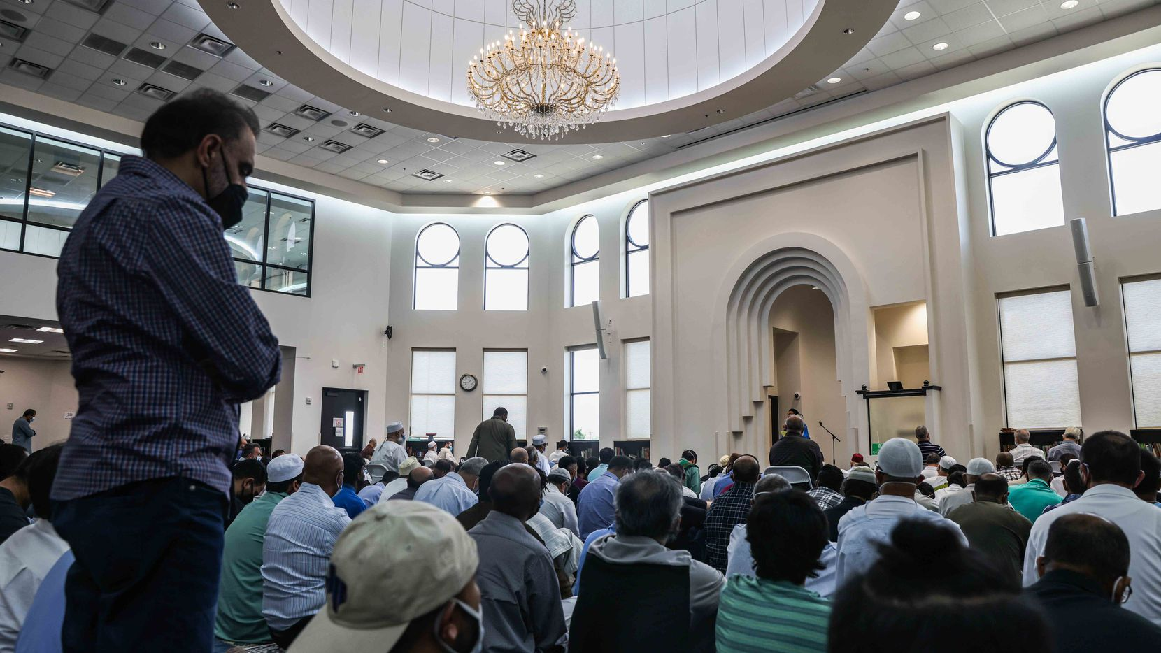 A group of Muslim men gather at the mosque main prayer hall to celebrate Friday afternoon prayer and lecture at the East Plano Islamic Center on August 27, 2021.