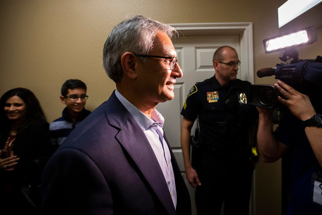 Tarrant County Republican Party vice chair Dr. Shahid Shafi smiles as he departs a press conference after a meeting of county party executive committee at Faith Creek Church Thursday, Jan. 10, 2019, in Richland Hill.