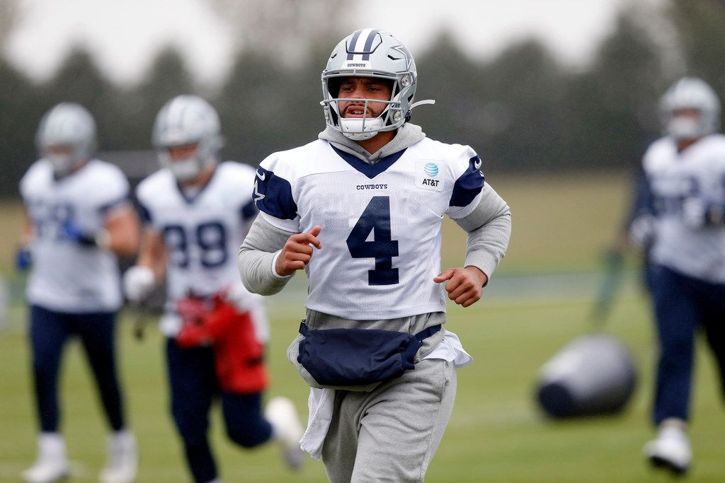 Dallas Cowboys quarterback Dak Prescott (4) warms up with the team during practice at The Star in Frisco, Tuesday, October 29, 2019.