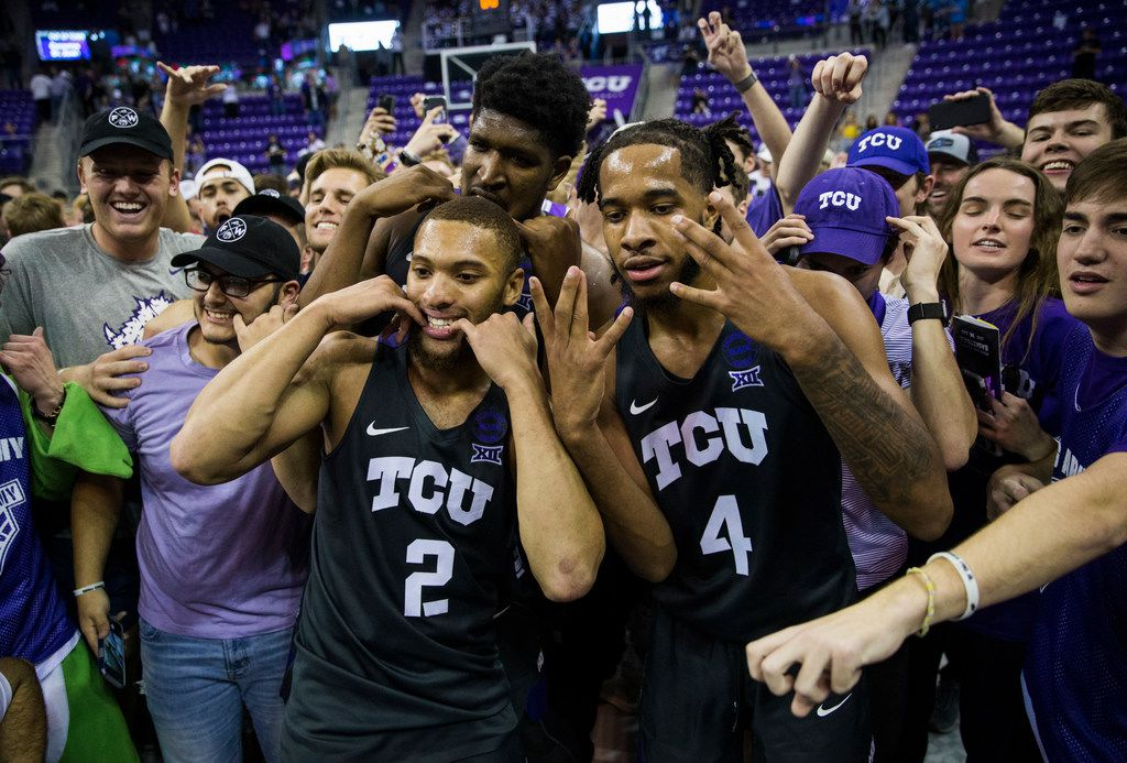 TCU Horned Frogs center Kevin Samuel (21), guard Devonte Bandoo (2), and guard PJ Fuller (4) celebrate after fans rush the court because of a 75-72 win over Baylor on Saturday, February 29, 2020 at Ed & Rae Schollmaier Arena on the TCU campus in Fort Worth. (Ashley Landis/The Dallas Morning News)