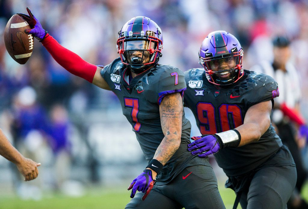 FILE - TCU safety Trevon Moehrig (7) celebrates an interception with defensive tackle Ross Blacklock (90) during the third quarter of a game against Texas on Saturday, Oct. 26, 2019, at Amon G Carter Stadium in Fort Worth.