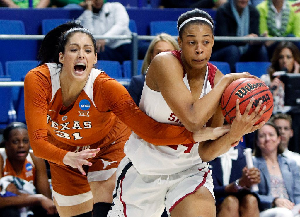 Stanford's Erica McCall, right, is pressured by Texas' Audrey-Ann Caron-Goudreau during a regional semifinal in the women's NCAA college basketball tournament in Lexington, Ky., Friday, March 24, 2017. Stanford won 77-66. (AP Photo/James Crisp)p