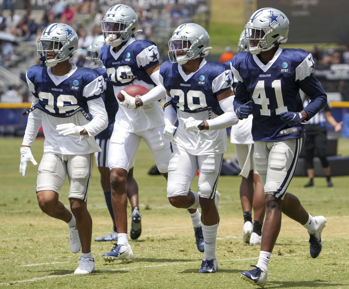Dallas Cowboys cornerback Kyron Brown (36), cornerback Israel Mukuamu (38), safety Tyler Coyle (39) and cornerback Reggie Robinson II (41) come off the field during a practice at training camp on Wednesday, July 28, 2021, in Oxnard, Calif.