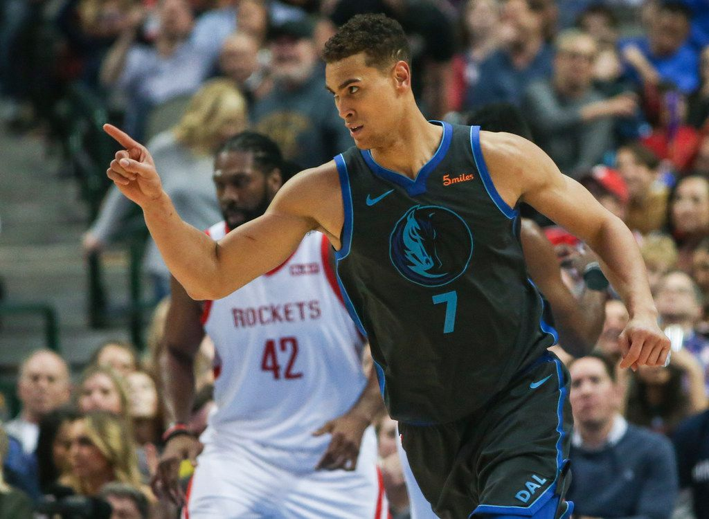 Dallas Mavericks forward Dwight Powell (7) celebrates a play during the second half a matchup between the Dallas Mavericks and the Houston Rockets on Sunday, March 10, 2019 at the American Airlines Center in Dallas.