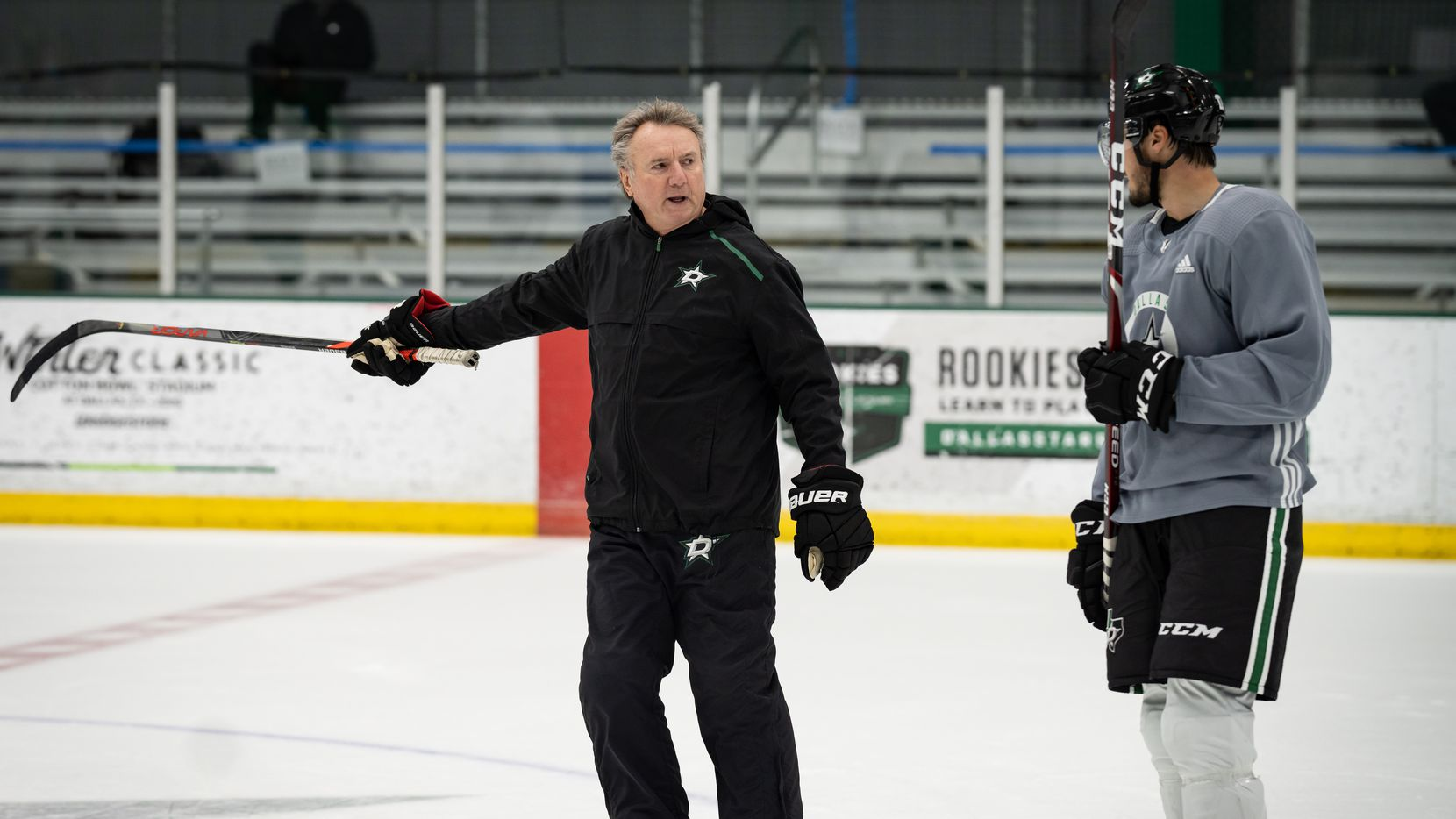 Stars interim coach Rick Bowness gives direction during a training camp practice on July 15, 2020.