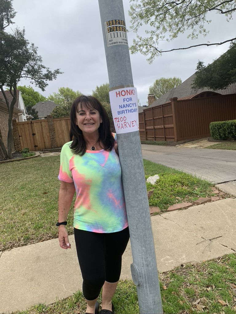 Nancy Blumenthal of Plano was surprised when she opened her front door on March 21, only to see her friend group singing happy birthday to her, standing 6 feet apart. Blumenthal had felt down about celebrating her 64th birthday without her friends, so the surprise turned her day around. (Photo courtesy of Nancy Blumenthal)