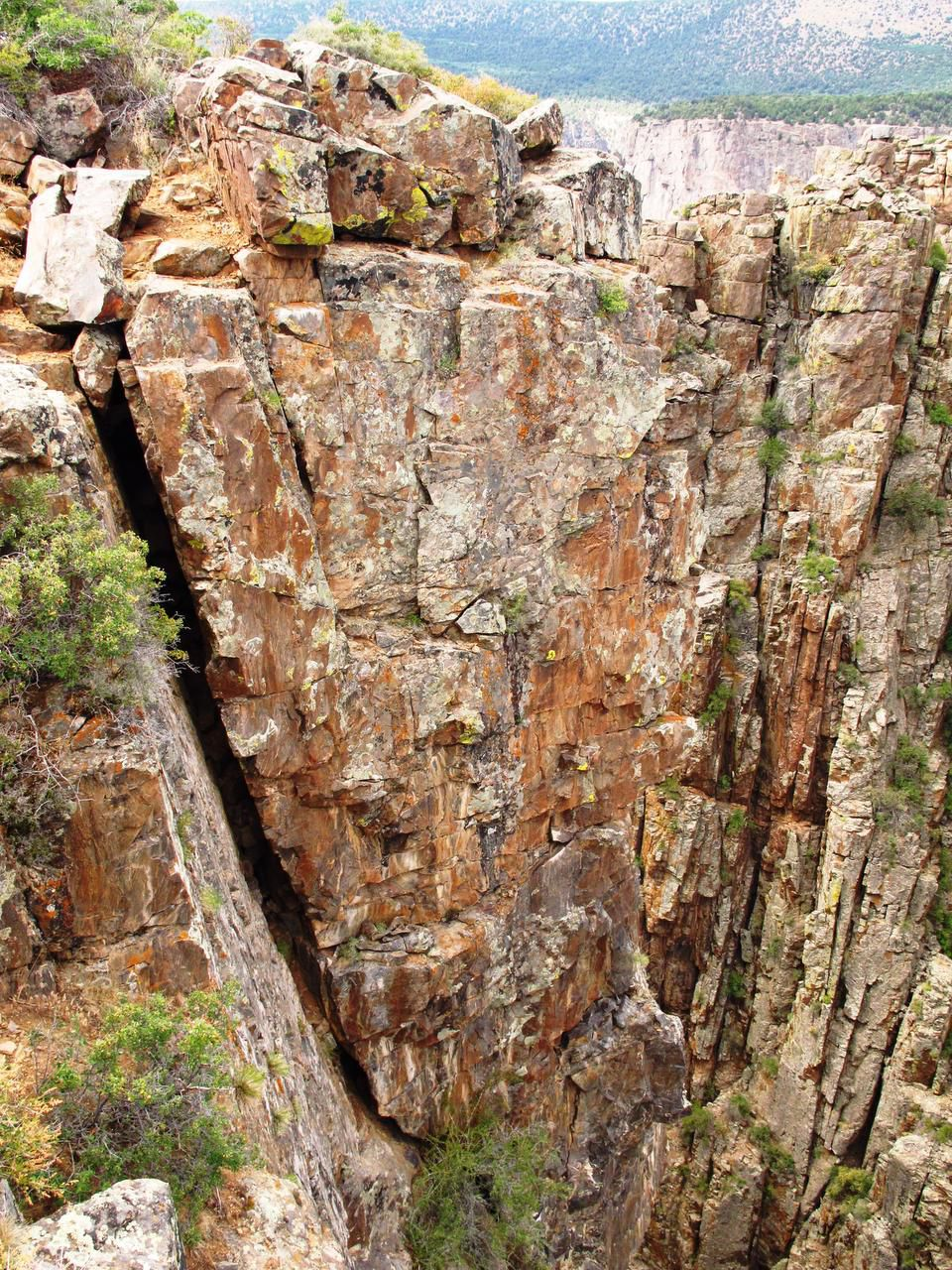 Fissures in the rock walls show the effects of wind and weather over thousands of years.