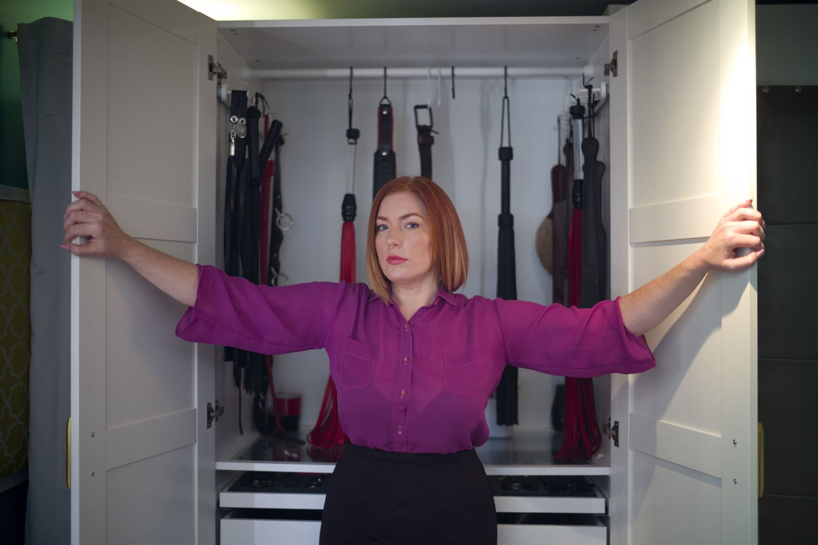 """Grace Marie, a sex worker and dominatrix, shown in 2015, in Los Angeles. As someone who posts advertisements on Backpage.com, she says, """"Sex workers can advertise from the safety of their home, and they don't have to rely on a third party for protection or promotion."""" The bigger concern among law enforcement, however, is sex trafficking."""