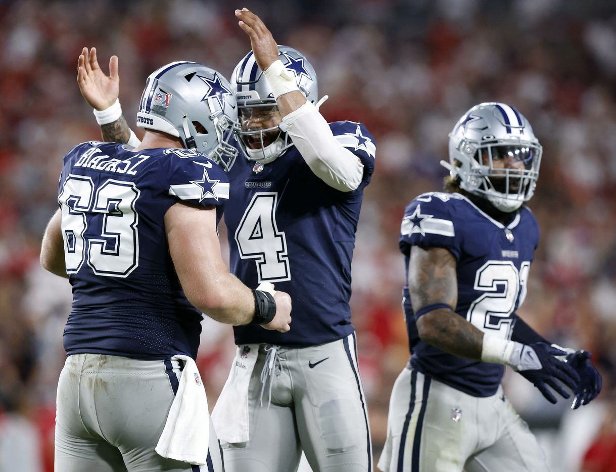 Dallas Cowboys quarterback Dak Prescott (4) and his center Tyler Biadasz (63) celebrate Amari Cooper's second quarter touchdown catch against the Tampa Bay Buccaneers at Raymond James Stadium in Tampa, Florida, Thursday, September 9, 2021. The Cowboys faced the Tampa Bay Buccaneers in the NFL season opener. (Tom Fox/The Dallas Morning News)