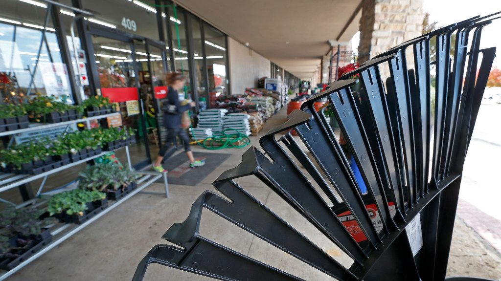 Customer Jane Griffin walks out of the new Rooster Home & Hardware store after shopping for Christmas gifts in Dallas, Monday, Nov. 28, 2016. The eco-friendly hardware store specializes in urban farming, beekeeping, live chickens, supplies and local products. (Jae S. Lee/The Dallas Morning News)
