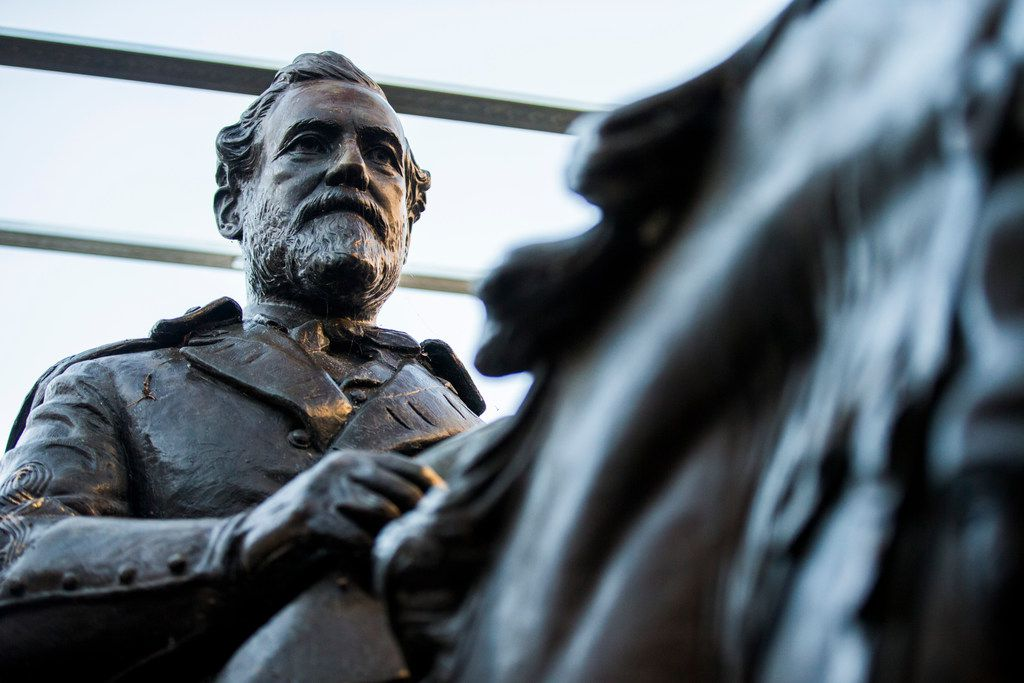 The 1935 statue of Robert E. Lee, by sculptor Alexander Phimister, sits in storage at Hensley Field, the former Naval Air Station on the west side of Mountain Creek Lake in Dallas. The buyer of the Lee statue for more than $1.4 million in a Dallas auction has been identified as a local law firm but the reason for the purchase still remains unclear. City leaders drew a top bid of $1,435,000 for the bronze sculpture from Dallas based Holmes Firm PC last week.