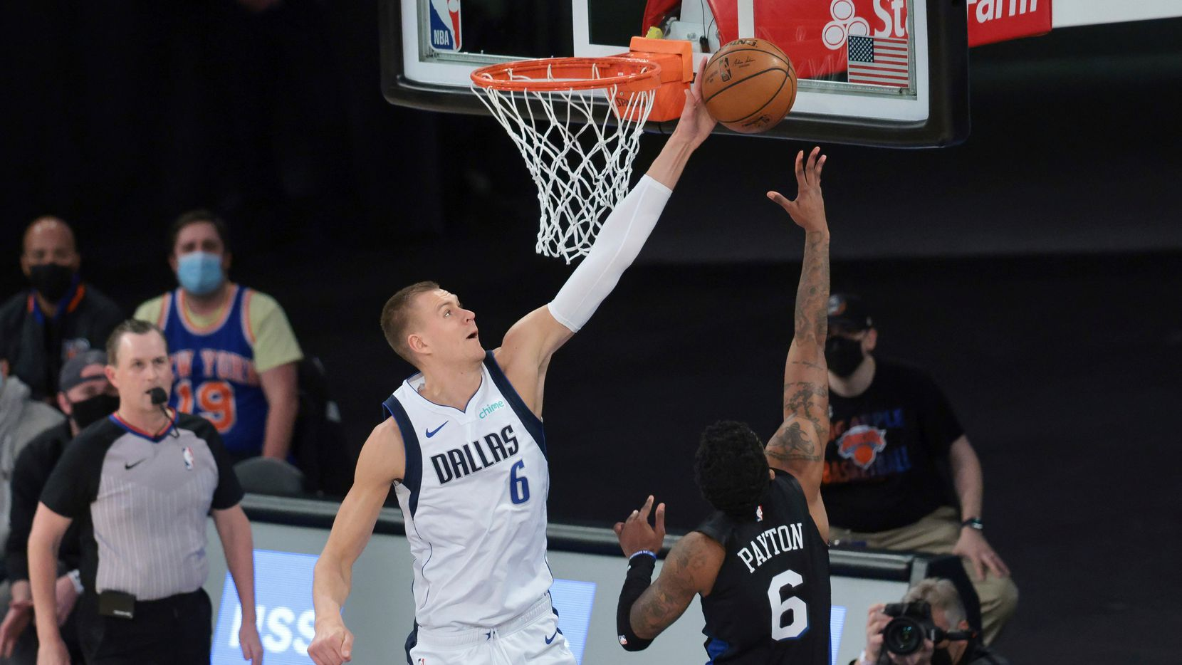 Dallas Mavericks center Kristaps Porzingis (6) blocks a shot by New York Knicks guard Elfrid Payton (6) during the first quarter of an NBA basketball game Friday, April 2, 2021, in New York.