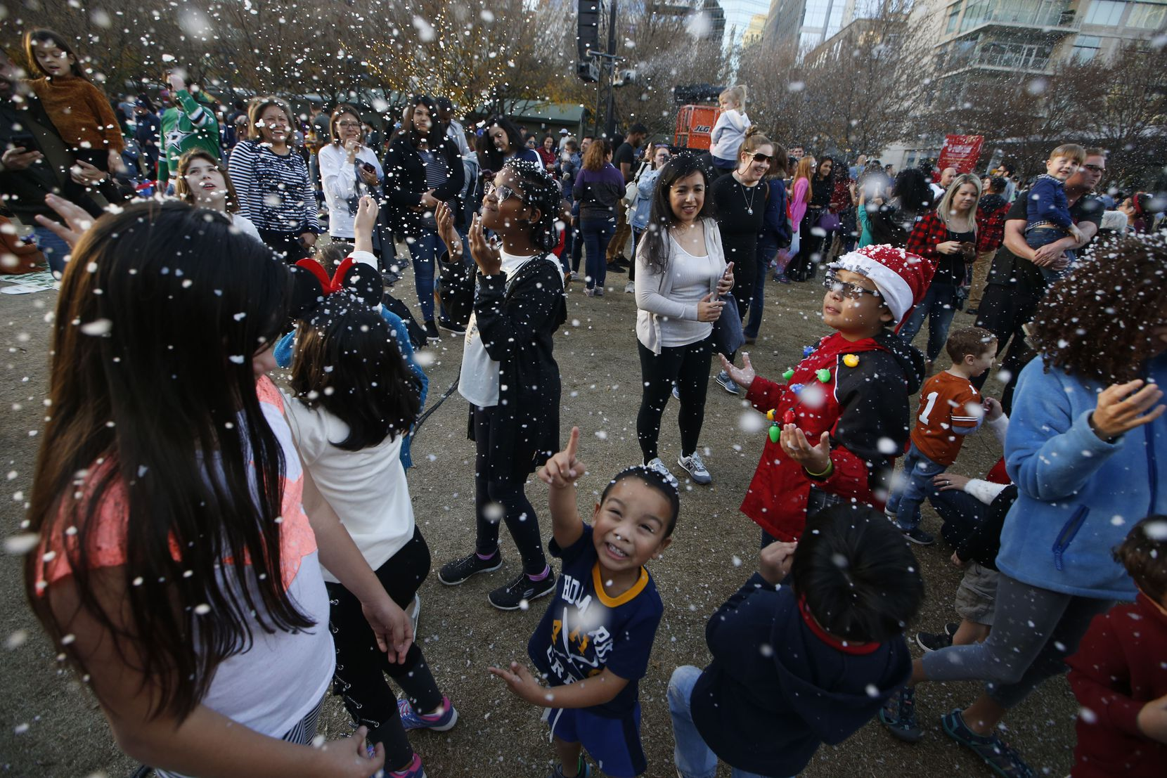 Kids play in fake snow during the 2018 tree lighting celebration at Klyde Warren Park. This year's event is Dec. 7.