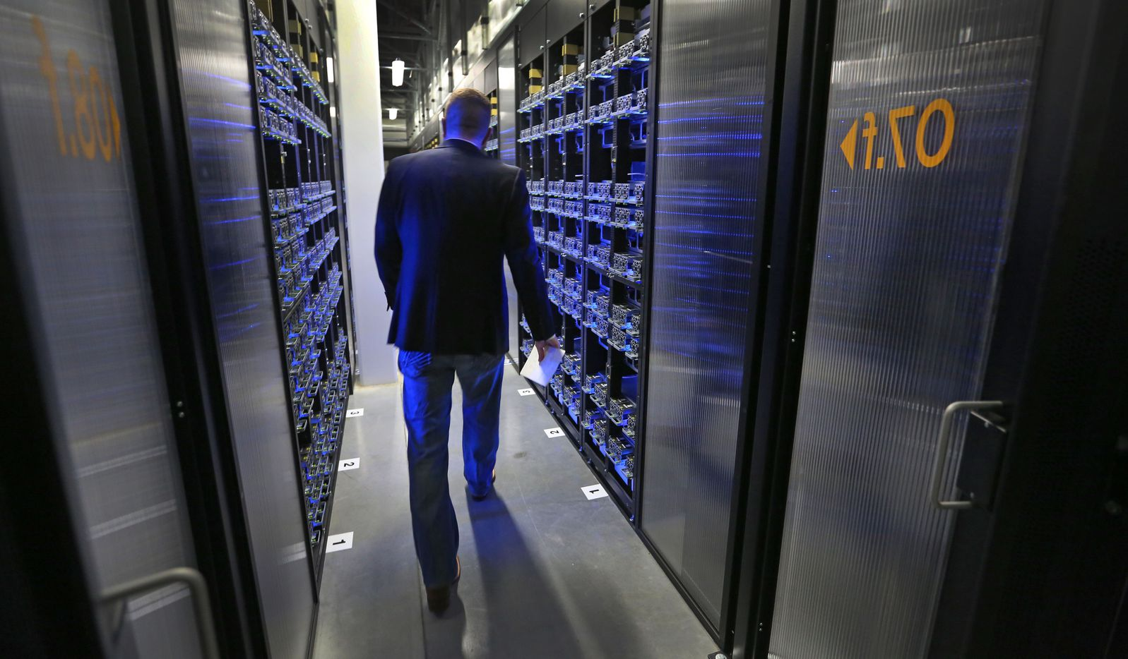 Site Manager KC Timmons walks a through a section of the data room during the media tour of Facebook's Fort Worth Data Cente.