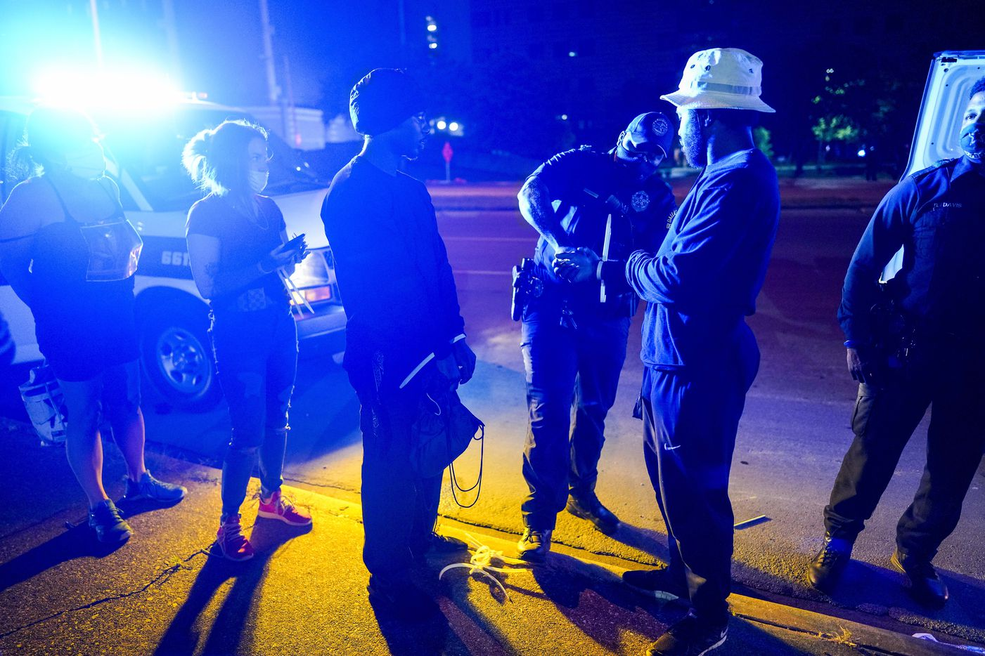 Protesters have their disposable cuffs removed as they are released outside the Frank Crowley Courthouse after being arrested on the Margaret Hunt Hill Bridge while demonstrating against police brutality on Monday, June 1, 2020, in Dallas. Protests continued Monday, a week after the death of George Floyd.