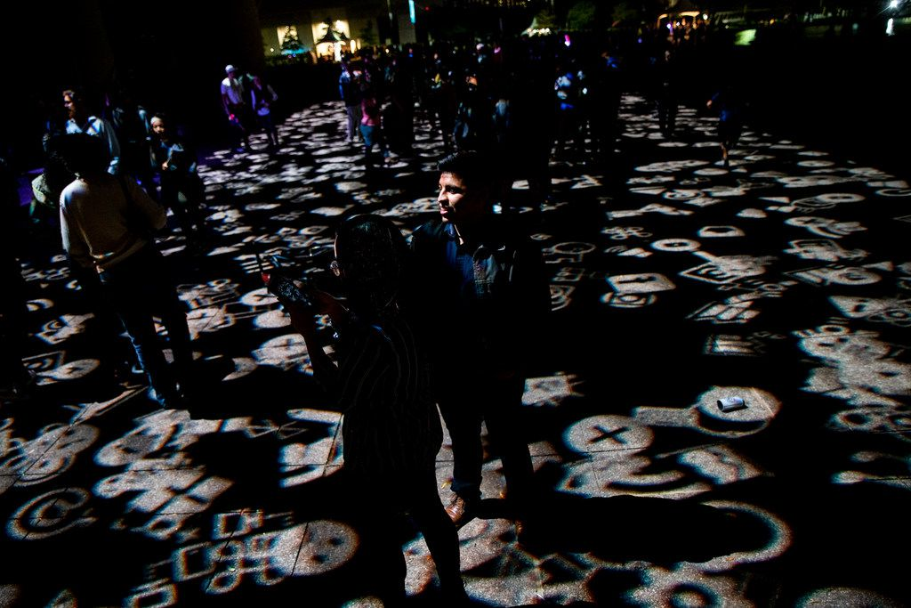 Rick Garcia, of Duncanville, Texas, stands and watches an exhibit during AURORA in Downtown Dallas on Saturday, November 3, 2018.