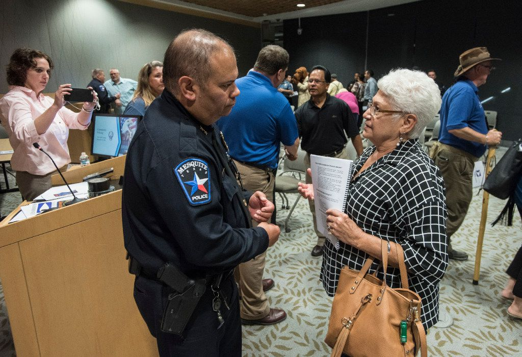 """Mesquite Police Chief Charlie Cato listens to a concern from Nancy Mallow after a town hall meeting on community policing in September 2016. The department recently added a """"20-4-7"""" program as a tool to get residents involved, asking them to go outside for 20 minutes four times a week."""