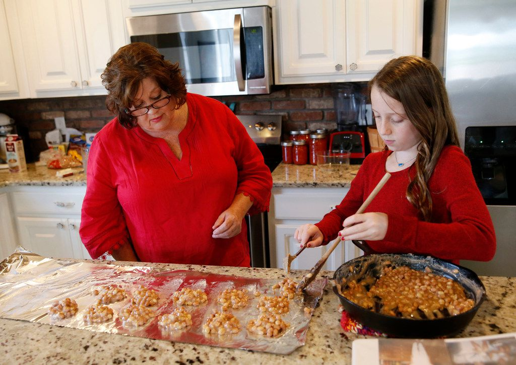 Tena Gilbert of Princeton watches as Aubrey Reeves places Peanut Patties on a sheet of foil