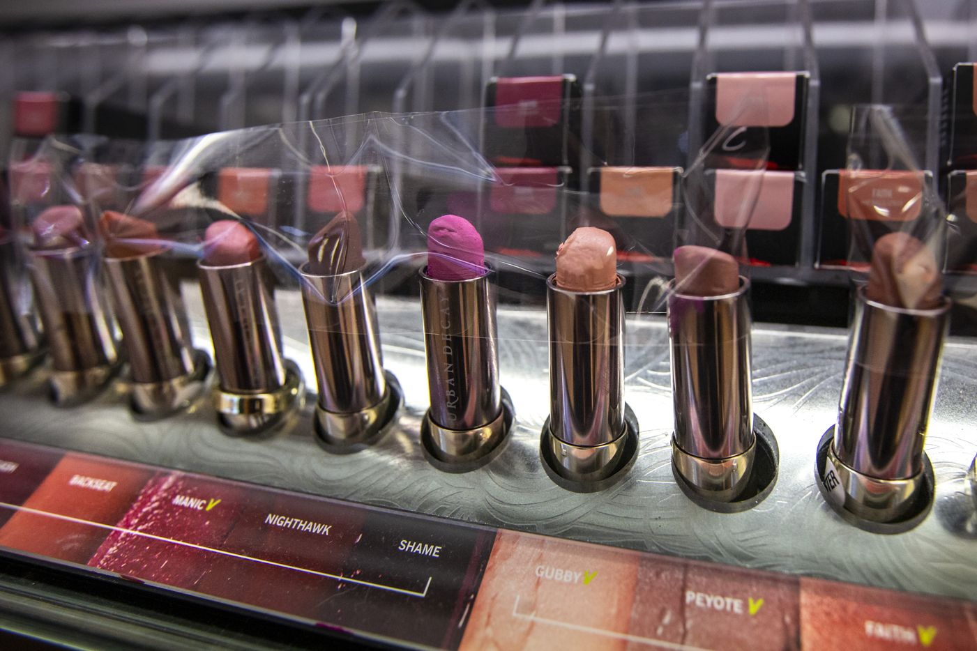 A row of taped-up sample lip products is on display only at the Ulta Beauty store. Before the virus outbreak, customers were allowed to use makeup applicators to sample lip colors.