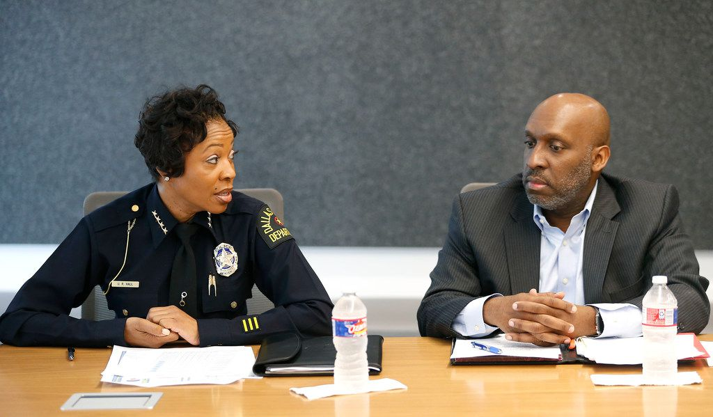 Dallas Police Chief U. Renee Hall looks at Dallas City Manager T.C. Broadnax during a meeting with Dallas Morning News editorial board members on June 15, 2018.