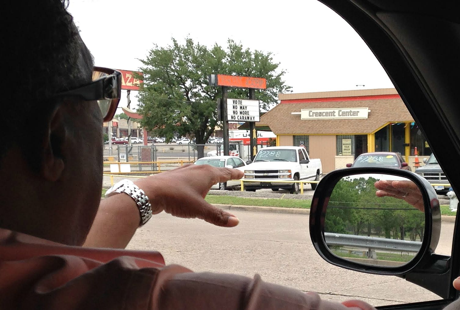 Caraway points out the anti-Caraway sign posted in his district, near Big T Plaza.