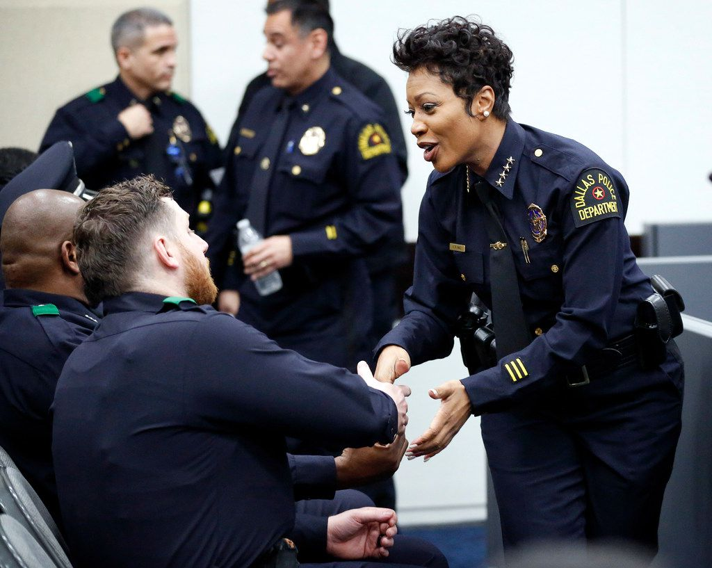 Dallas Police Chief Renee Hall congratulates her police officers who were recognized before Dallas council members for their actions in helping an out-of-state family get settled into a hotel after a major crash in Dallas. The recognition was at Dallas City Hall on Jan. 14, 2019.