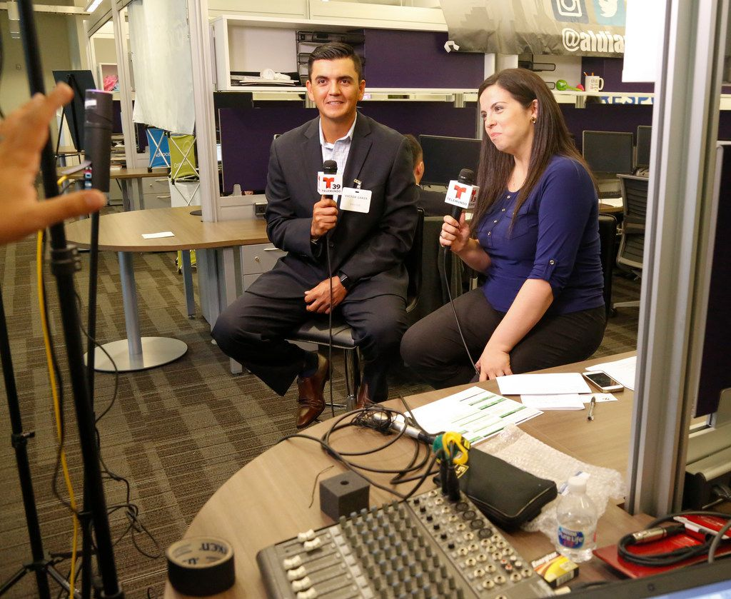 Certified financial planner Victor Garza and Al Dia's Silvana Pagliuca prepare to go Facebook Live at The Dallas Morning News'  annual financial call-in on Oct. 5. The call-in was held at  NBC Channel 5 offices in Fort Worth.