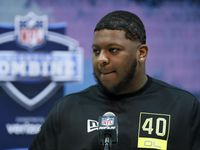 FILE - Michigan offensive lineman Cesar Ruiz speaks during a press conference at the NFL scouting combine in Indianapolis on Wednesday, Feb. 26, 2020.