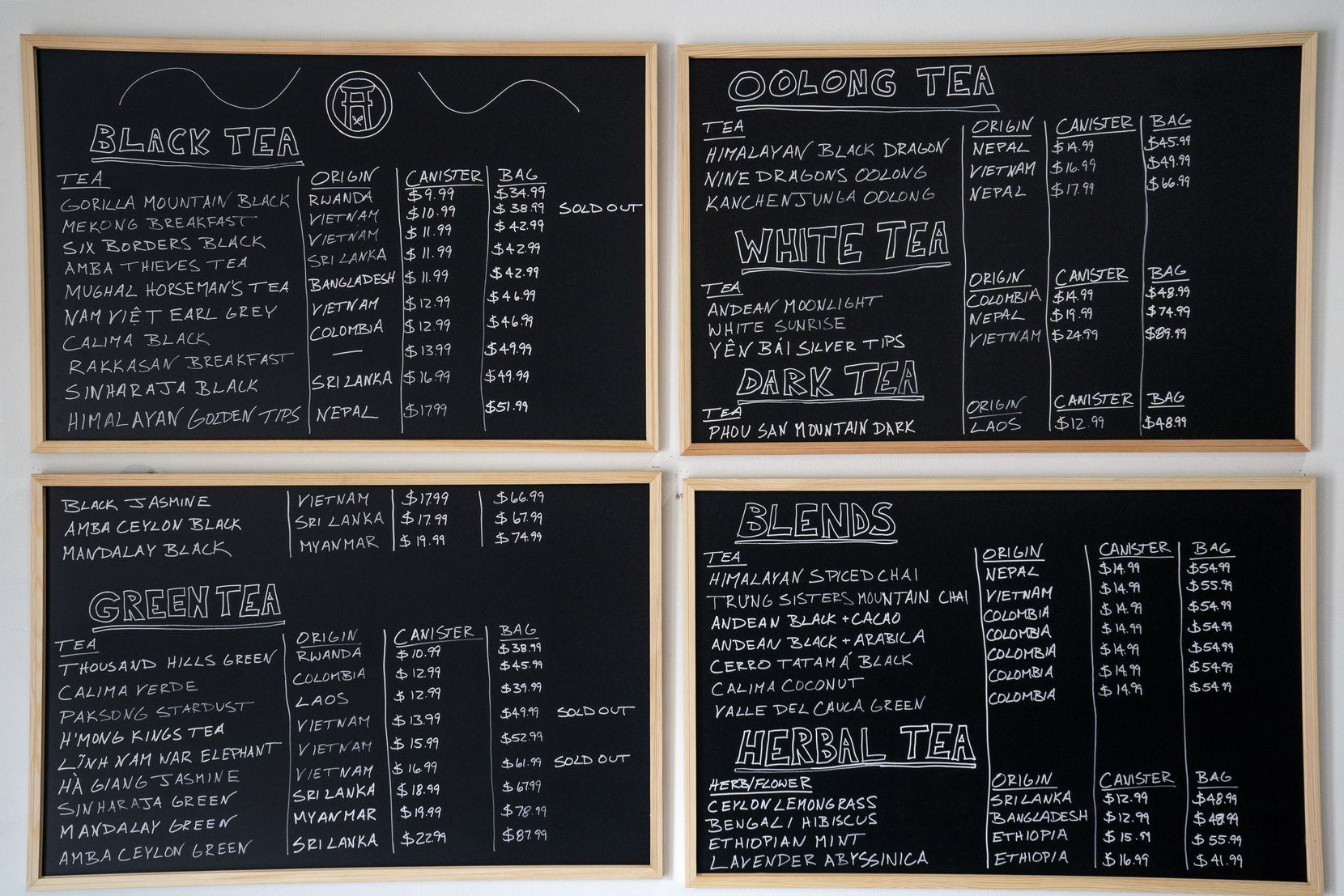 A blackboard menu hangs on the wall of Rakkasan Tea near Hall Street and Ross Avenue in Dallas.