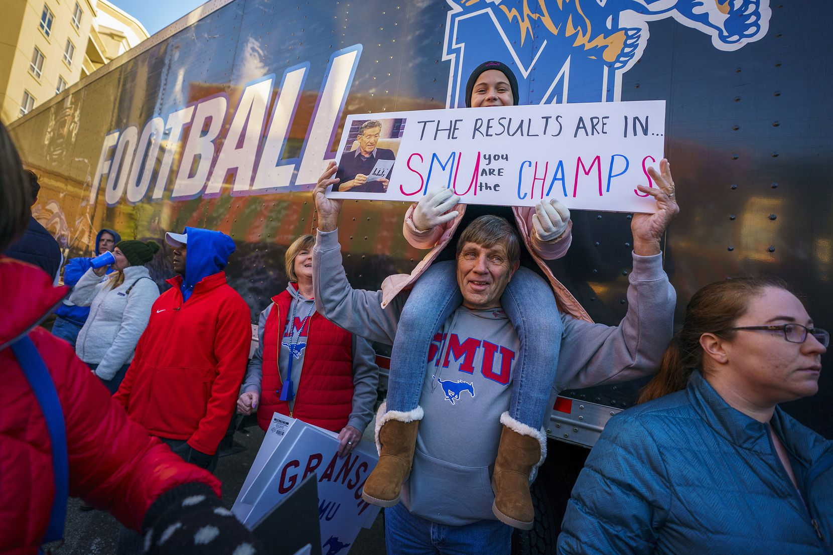 Ellie Granson, younger sister of SMU tight end Kylen Granson, holds a sign atop the shoulders of her uncle Bob Groen during ESPN College GameDay on Beale Street before an NCAA football game  on Saturday, Nov. 2, 2019, in Memphis, Tenn.