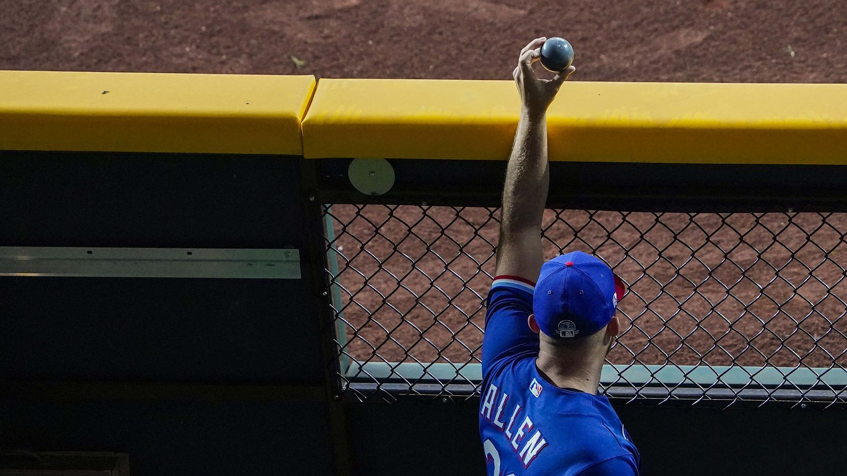 Texas Rangers pitcher Cody Allen holds up a weighted ball in the bullpen during the Rangers first Summer Camp workout at Globe Life Field on Friday, July 3, 2020, in Arlington. (Smiley N. Pool/The Dallas Morning News)