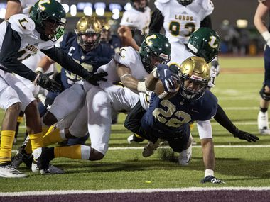 Jesuit senior running back E.J. Smith (22) reaches for the goal line on his fourth touchdown run of the game in the second half an area round high school football playoff game against Longview on Friday, November 22, 2019 at John Kincaide Stadium Dallas. (Jeffrey McWhorter/Special Contributor)