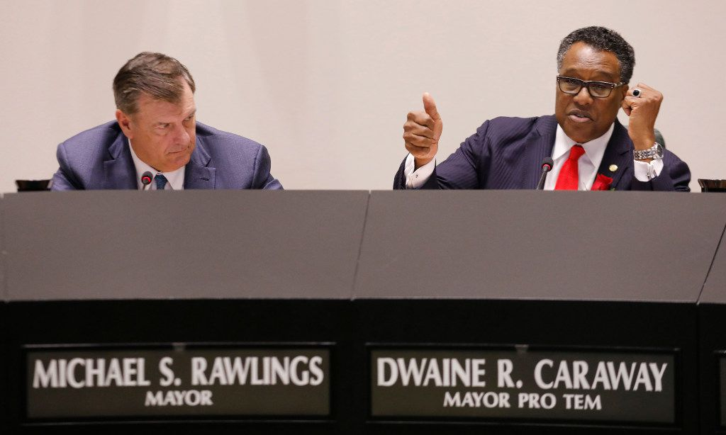 Dallas Mayor Mike Rawlings, left, listens as Mayor Pro Tem Dwaine Caraway makes a final plea for a yes vote during the Dallas City Council meeting debating weather to remove the Robert E. Lee statue at Robert E. Lee Park in Dallas on Wednesday, September 6, 2917.  The council voted 12-1 to remove the statue and Councilmember Rickey Callahan did not vote. (David Woo/The Dallas Morning News)