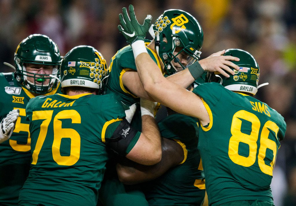 Baylor Bears quarterback Charlie Brewer (12) celebrates a touchdown with his team during the first quarter of an NCAA football game between Baylor University and Oklahoma University on Saturday, November 16, 2019 at McLane Stadium in Waco, Texas.