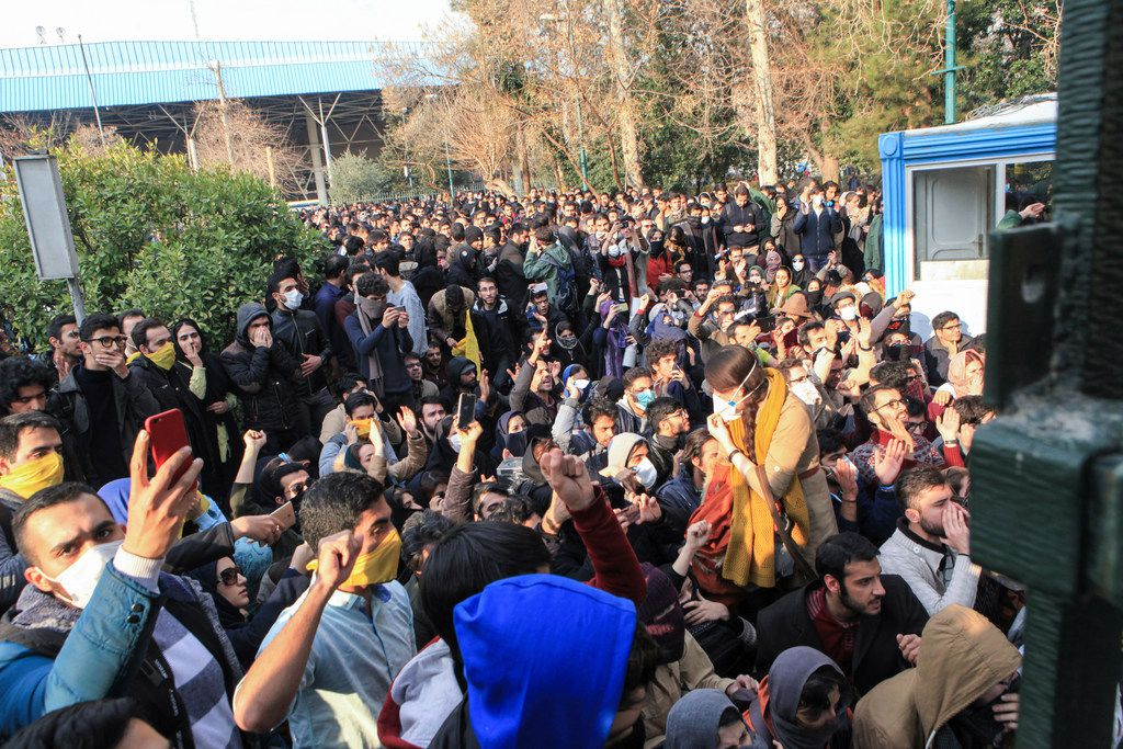 In this Saturday, Dec. 30, 2017 file photo taken by an individual not employed by the Associated Press and obtained by the AP outside Iran, university students attend a protest inside Tehran University while anti-riot Iranian police prevent them to join other protestors, in Tehran, Iran. As protests over Iran's faltering economy rapidly spread across the country, a channel on a mobile messaging app run by an exiled journalist helped fan the passions of some of those who took to the street. The Telegram app shut down a channel run by Roohallah Zam after Iranian authorities complained that it was inciting violence. (AP Photo, File)