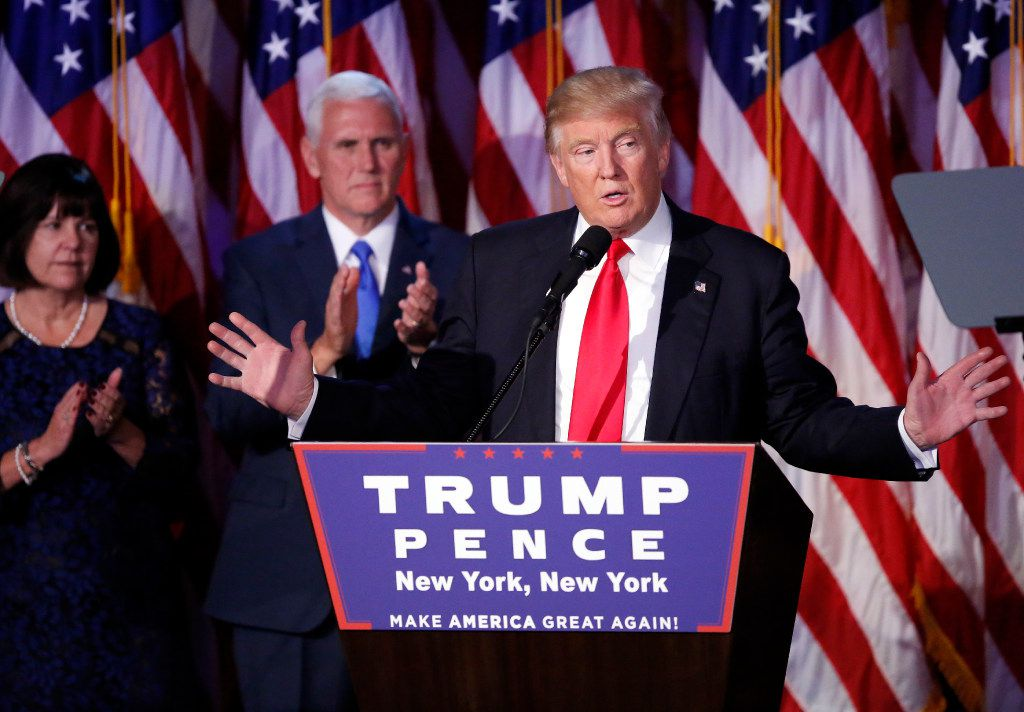 Donald Trump, with running mate Mike Pence, celebrated his victory and addressed his supporters early Wednesday in New York. (Tom Fox/Staff Photographer)