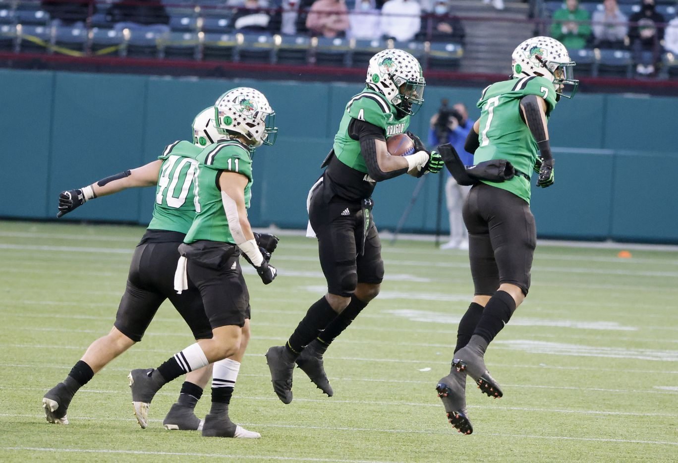 Southlake's Cinque Williams (4) celebrates his interception against Duncanville with teammates during the Class 6A Division I state high school football semifinal in Arlington, Texas on Jan. 9, 2020. (Michael Ainsworth)