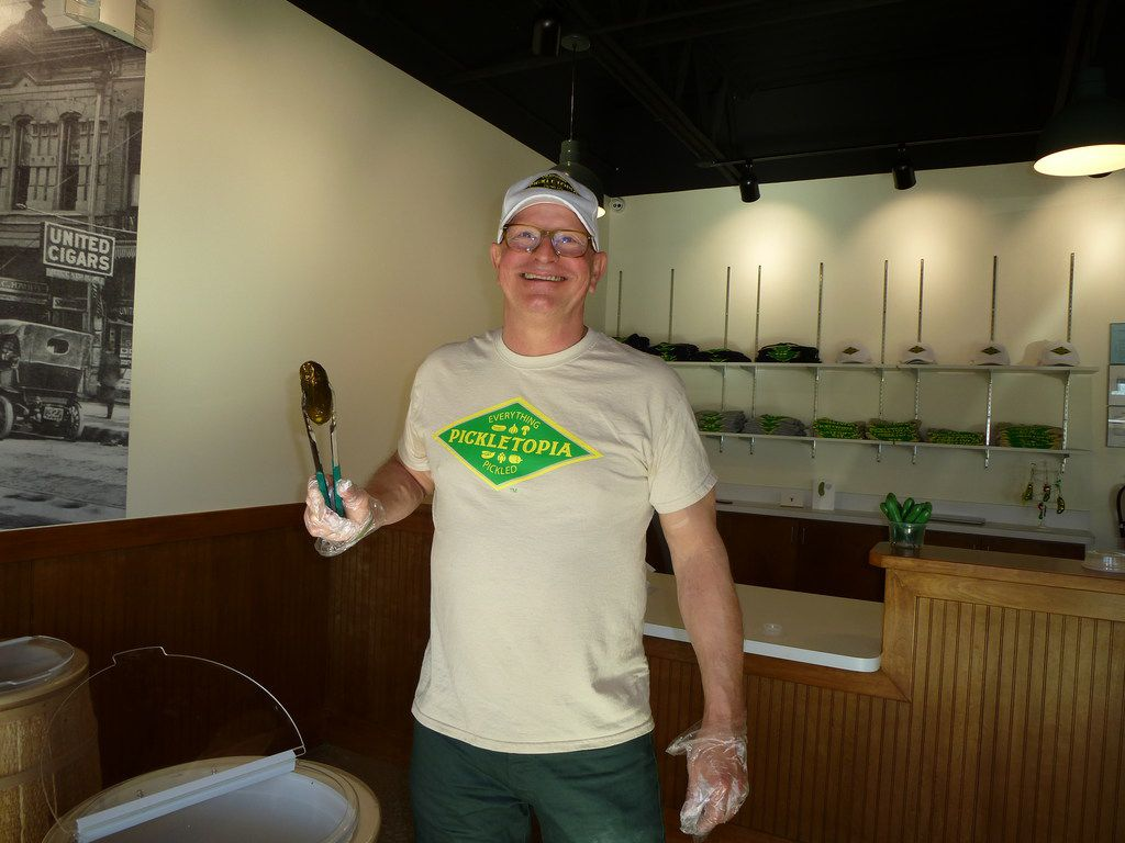 Lee Theilen turned his pickling hobby into a new artisan business, Pickletopia, which just had its soft opening. That's a full sour pickle he's holding.