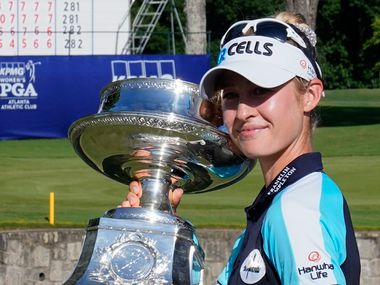 Nelly Korda of the U.S. holds the trophy after winning the KPMG Women's PGA Championship golf tournament, Sunday, June 27, 2021, in Johns Creek, Ga.