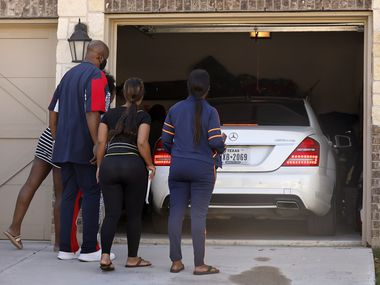 Family and friends of Timothy George Simpkins, 18, who was named as a suspect in the shooting at Timberview High School on Wednesday, surround him as he arrives home in Arlington on Thursday after being released on bond.