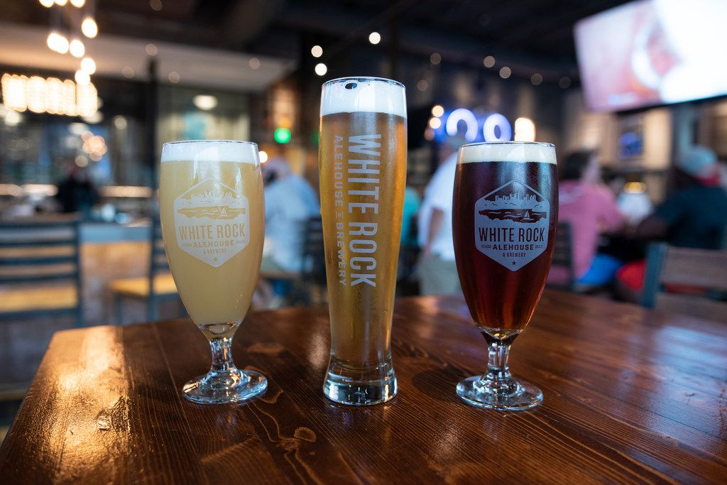 White Rock Alehouse makes eight of their beers on site.  From left is the IPO IPA, the Big Thicket Blonde and the Texas (G)IRL.