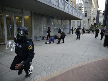 Dallas police begin clearing downtown Dallas as a 7 p.m. curfew begins Sunday.