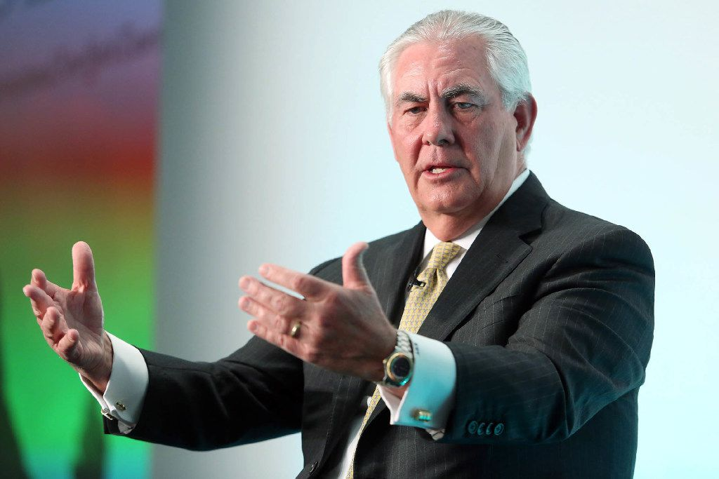 ExxonMobil CEO Rex Tillerson gestures as he speaks during the Oil and Money 2015 conference in London on Oct. 7, 2015. MUST CREDIT: Bloomberg photo by Chris Ratcliffe.
