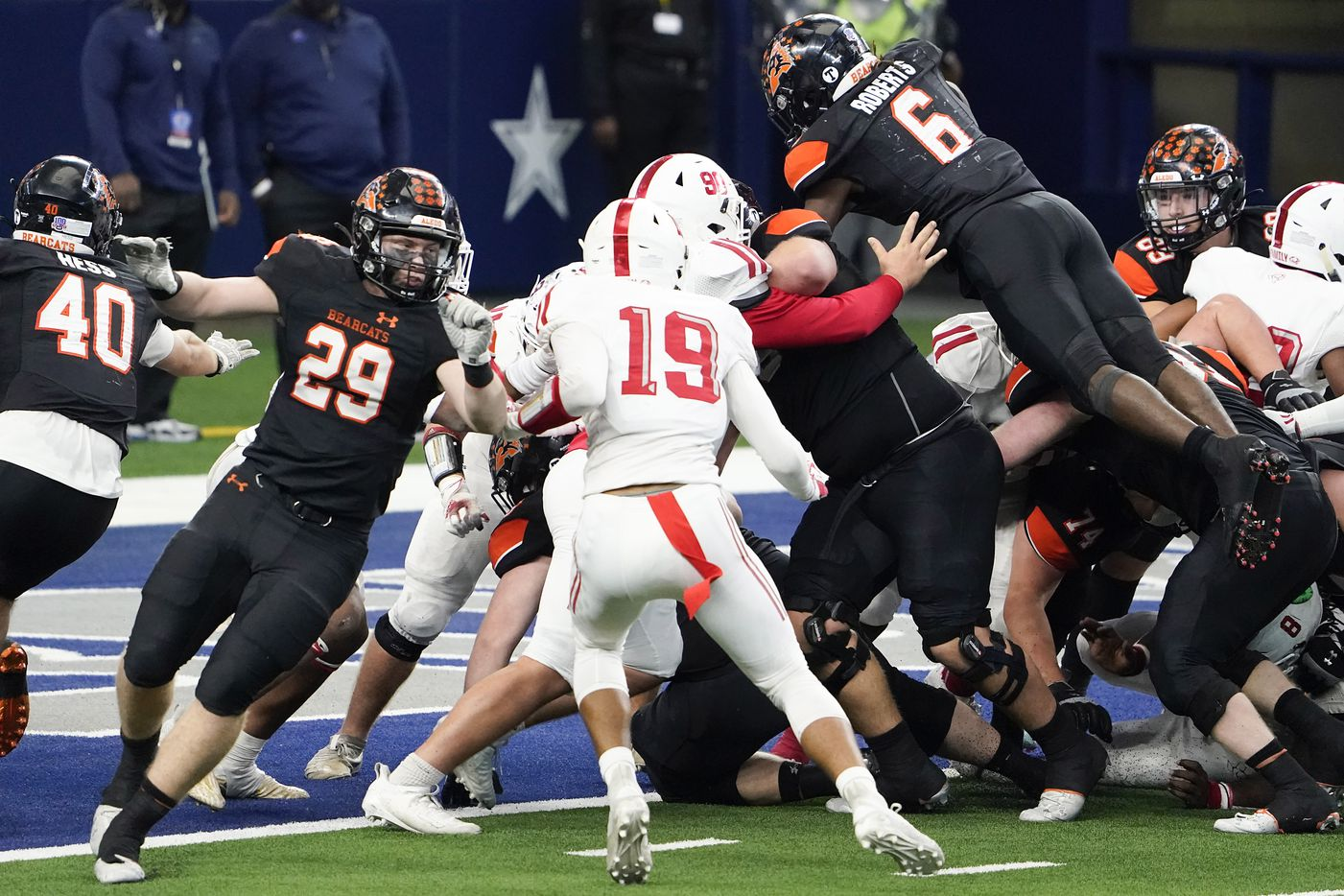 Aledo running back DeMarco Roberts (6) dives over the pile for a touchdown during the second half of a 56-21 victory over Crosby to win the Class 5A Division II state football championship game at AT&T Stadium on Friday, Jan. 15, 2021, in Arlington. The victory gave the Bearcats the 10th state championship in school history. (Smiley N. Pool/The Dallas Morning News)