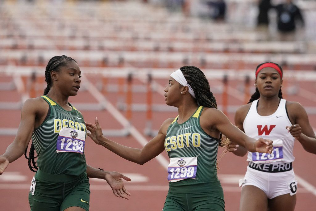DeSoto's Jayla Hollis (1293) greets teammate Jalaysi'ya Smith (1299) at the finish of the Class 6A girls 100-meter hurdles at the UIL state track and field meet. Hollis won, and Smith finished second. (Bob Daemmrich/Special Contributor)