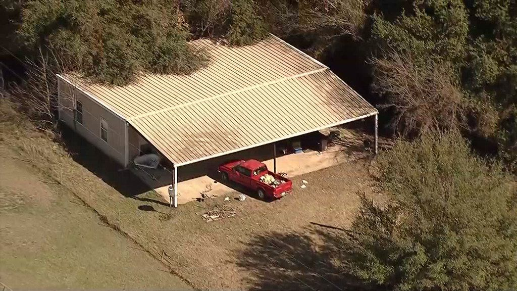 An aerial photo shows the home where officials say Wise County sheriff's deputies found four malnourished children under the age of 5, including two locked in a dog kennel. Their mother and a man identified as the father of one of the children were arrested and charged with four counts of endangering a child, Sheriff Lane Akin said.