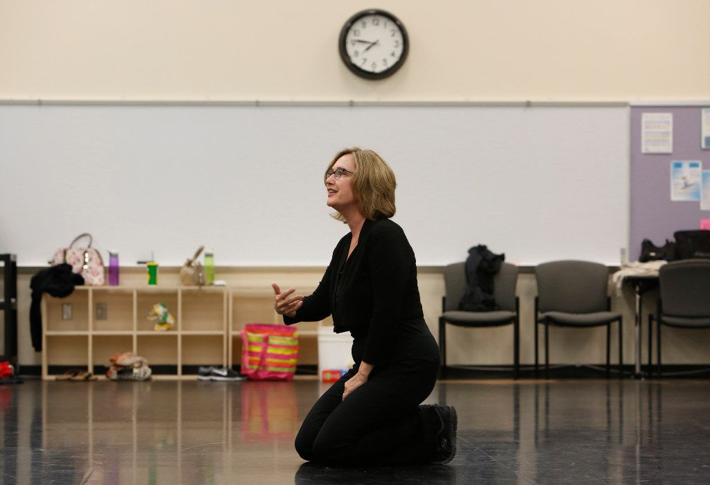 Elledanceworks co-founder Michele Hanlon talks to company members during a rehearsal at Collin College's Spring Creek Campus in Plano for their final shows. After 20 years, the company takes its last bows June 2-3 and June 9-10.